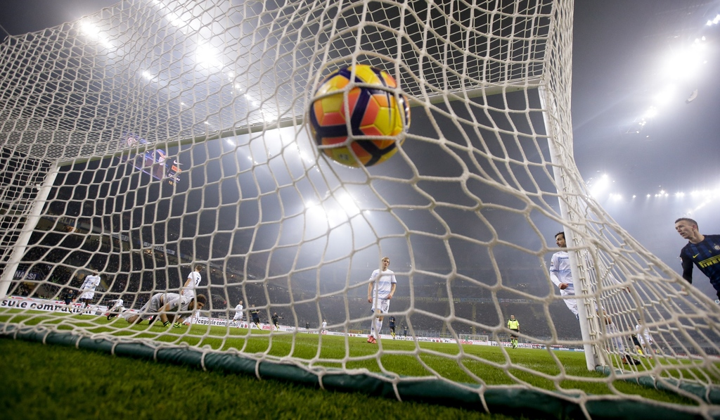 Inter Milan's Mauro Icardi scores during a Serie A soccer match between Inter Milan and Lazio, at the San Siro stadium in Milan, Italy,...