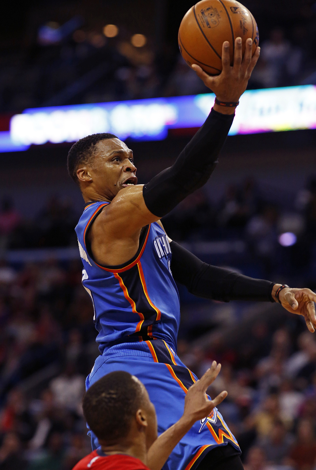 Oklahoma City Thunder guard Russell Westbrook, top, makes a layup against New Orleans Pelicans guard Tim Frazier, bottom, during the fi...
