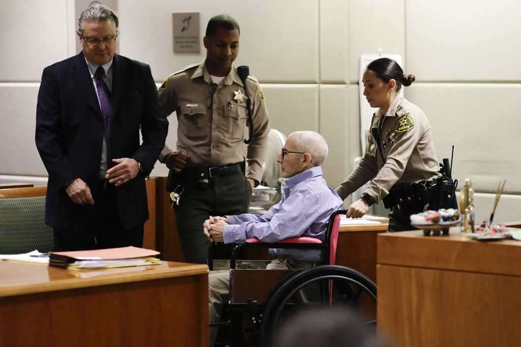 Real estate heir Robert Durst, center, is brought into a courtroom in the wheelchair for a hearing Wednesday, Dec. 21, 2016, in Los Ang...