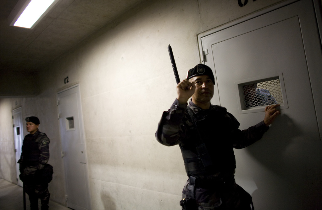 FILE - This March 30, 2011 file photo, show security guard inside the new maximum security pavilion at La Picota prison during a press ...