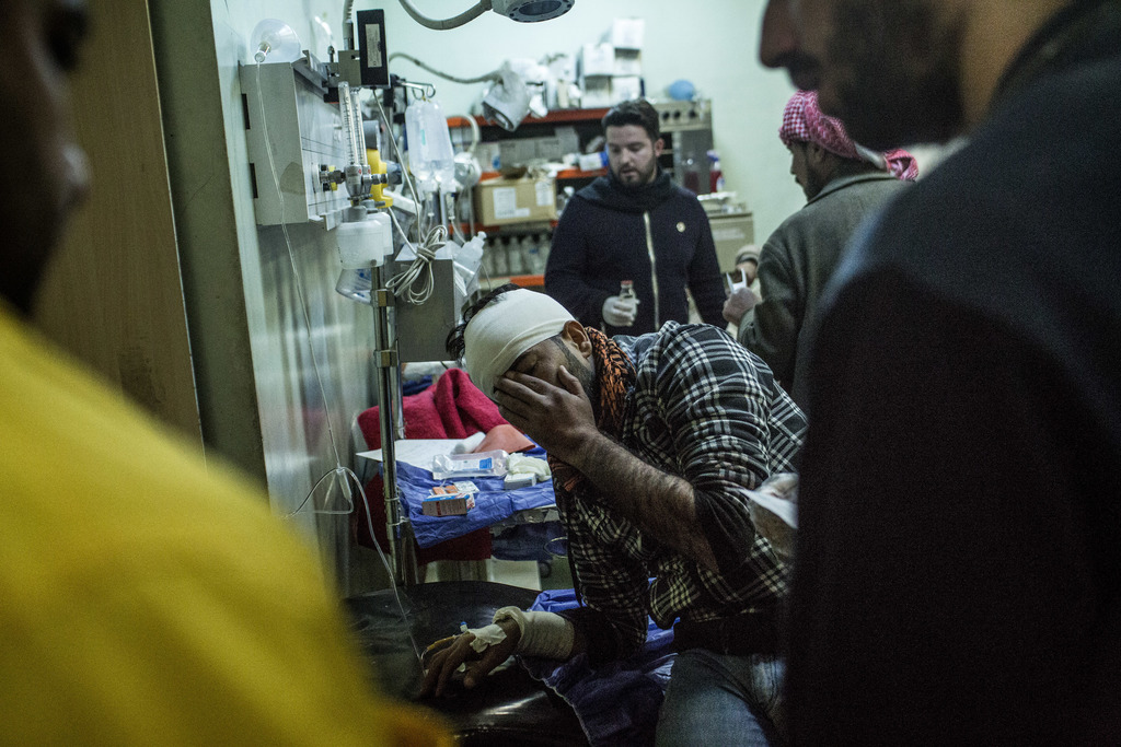 A Iraqi man wounded in a car bomb attack in the liberated district of Gogjali in Mosul reacts to pain at an emergency room in a hospita...