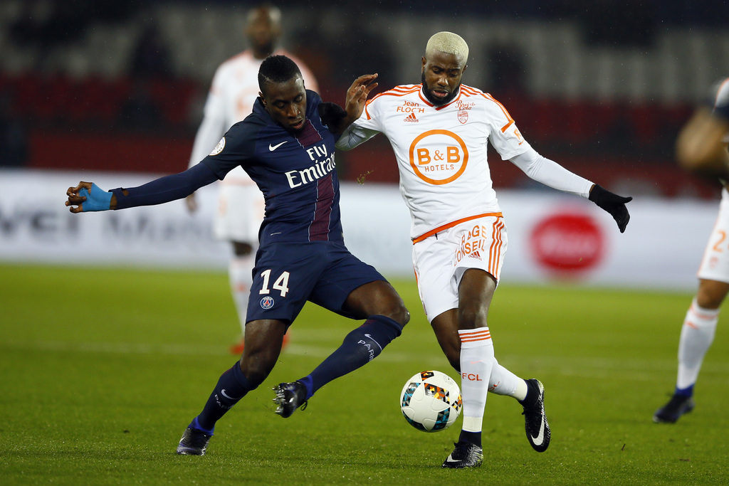 PSG's Blaise Matuidi, left, challenges for the ball with Lorient's Arnold Makengo Mvuemba during their French League One soccer match b...