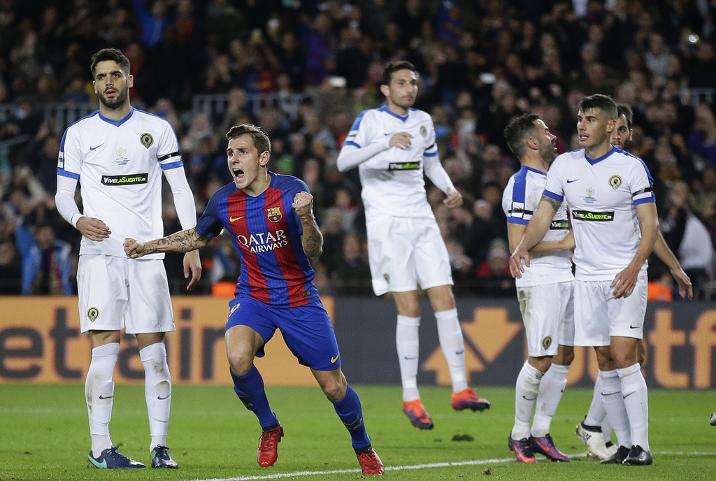 FC Barcelona's Lucas Digne, second left, reacts after scoring during the Copa del Rey, Spain's King's Cup soccer match between FC Barce...