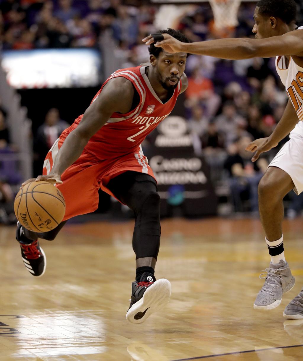 Houston Rockets guard Patrick Beverley (2) drives past Phoenix Suns guard Brandon Knight during the first half of an NBA basketball gam...