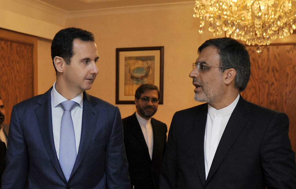 In this photo released by the Syrian official news agency SANA, Syrian President Bashar Assad, left, meets with Iranian Deputy Foreign ...