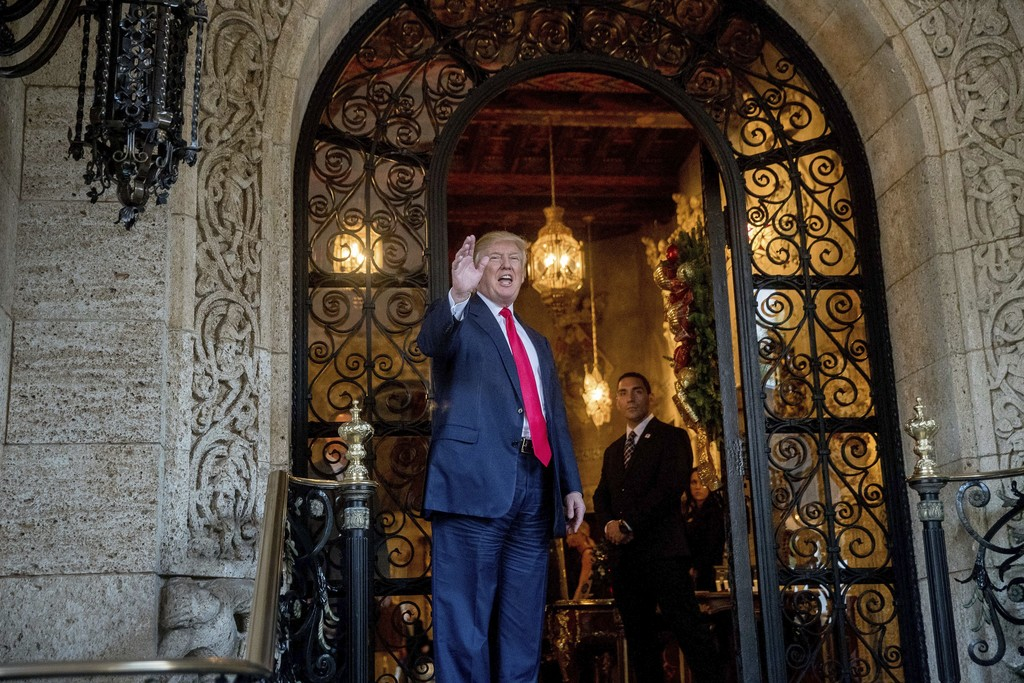 President-elect Donald Trump waves to members of the media after a meeting with admirals and generals from the Pentagon at Mar-a-Lago, ...