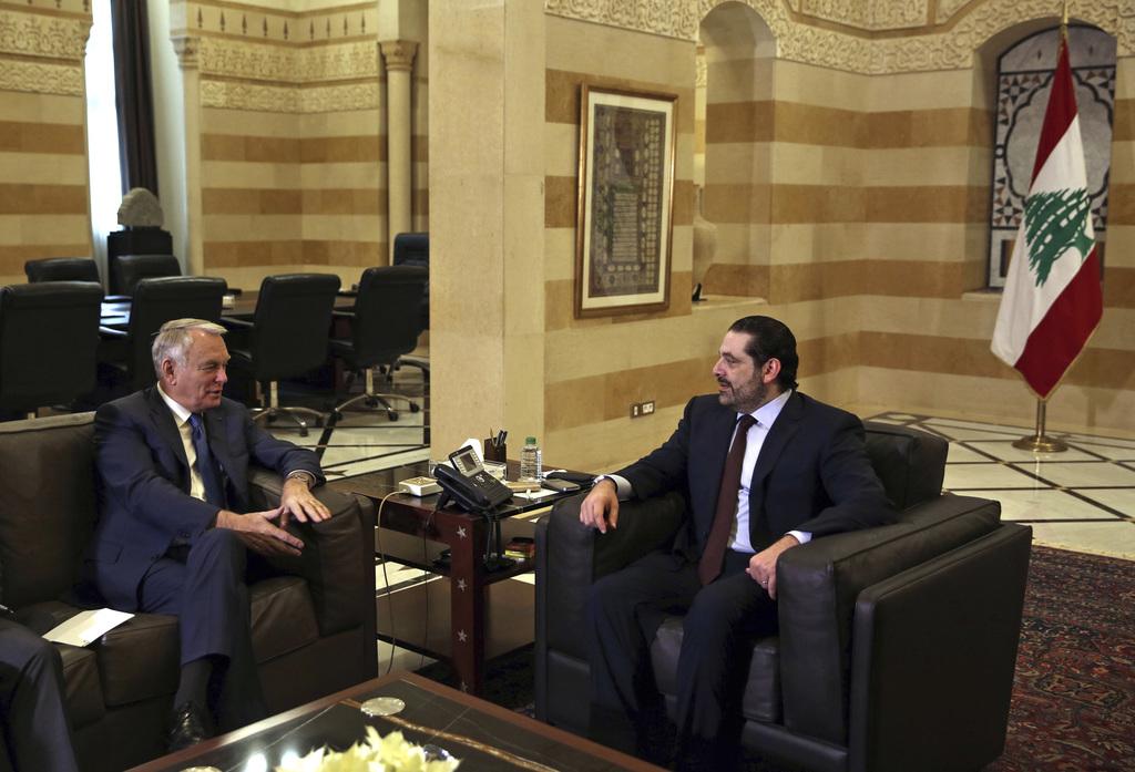 Lebanese Prime Minister Saad Hariri, right, meets with French Foreign Minister Jean-Marc Ayrault at the Government House in downtown Be...