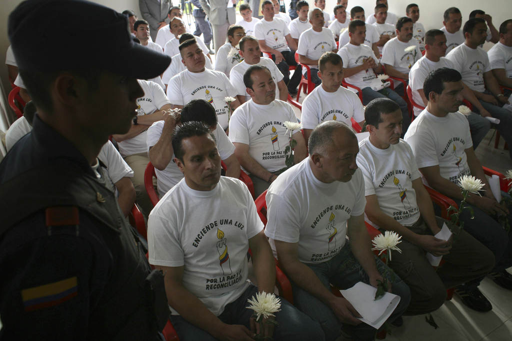 FILE - In this March 11, 2009 file photo, a group of rebels of the Revolutionary Armed Forces of Colombia attend a ceremony where they ...