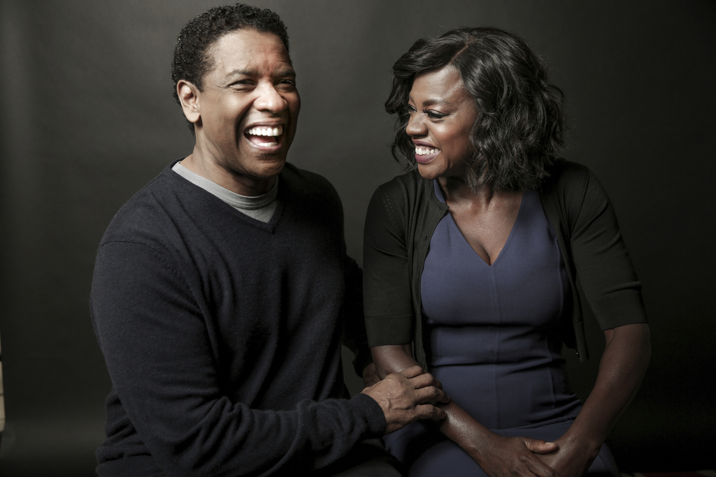 In this Saturday, Dec. 17, 2016 photo, Denzel Washington, left, and Viola Davis pose for a portrait at the Four Seasons, in Los Angeles...