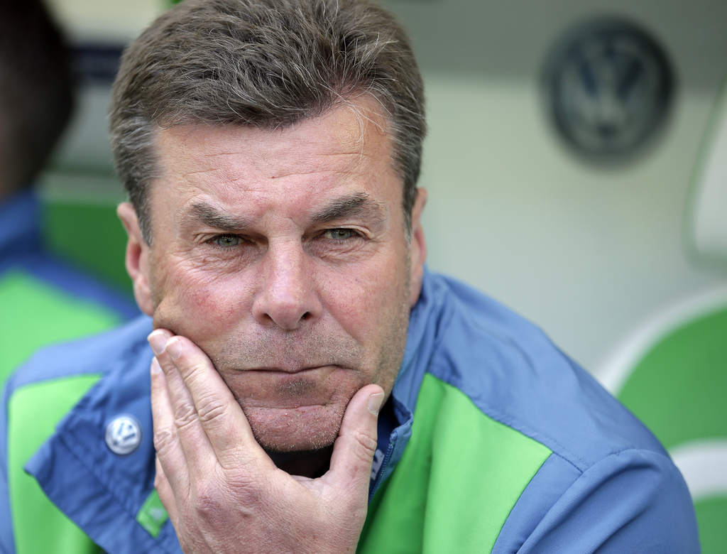 FILE - In this Saturday, May 14, 2016 file photo, Wolfsburg head coach Dieter Hecking arrives for the German Bundesliga soccer match be...