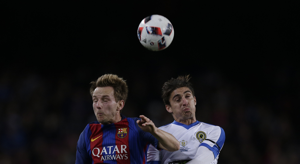 FC Barcelona's Ivan Krkic, left, duels for the ball against Hercules Berrocal during the Copa del Rey, Spain's King's Cup soccer match ...