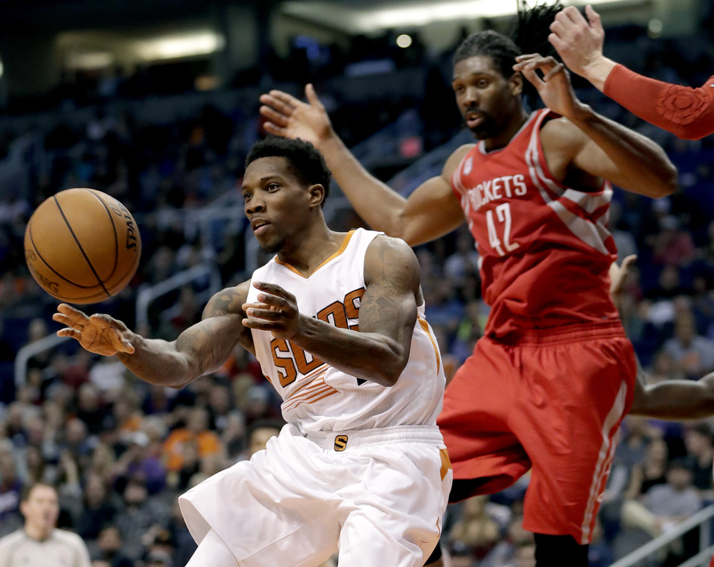 Phoenix Suns guard Eric Bledsoe passes the ball as Houston Rockets center Nene Hilario (42) defends during the second half of an NBA ba...