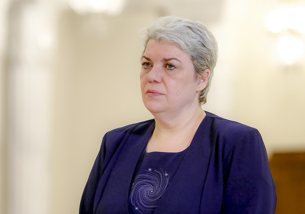 FILE - In this May 20, 2015 file photo, Sevil Shhaideh, 52, stands at the Romanian presidency before being sworn in as regional develop...