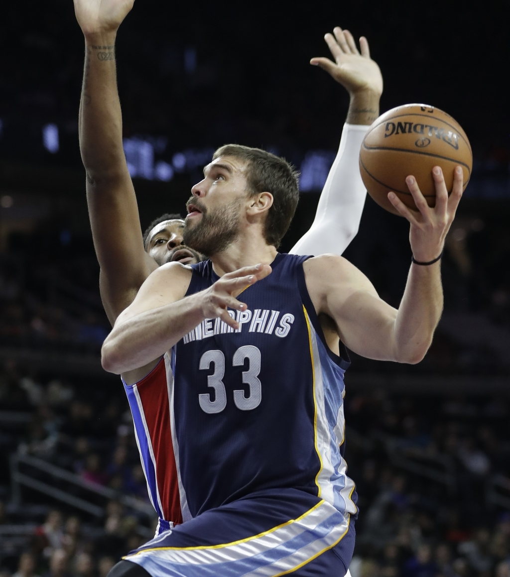 Memphis Grizzlies center Marc Gasol shoots while defended by Detroit Pistons center Andre Drummond during the second half of an NBA bas...