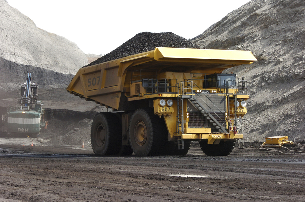 FILE - In this April 4, 2013, file photo, a mining dumper truck hauls coal at Cloud Peak Energy's Spring Creek strip mine near Decker, ...