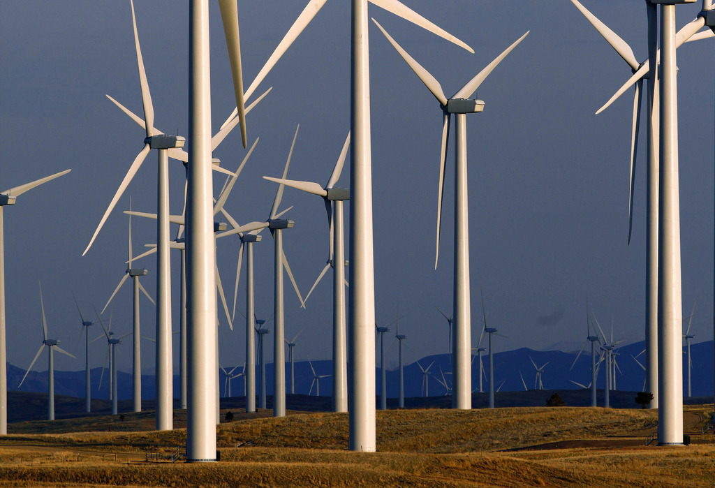 FILE - In this May 6, 2013, file photo, a wind turbine farm stands near Glenrock, Wyo. Renewable energy developers say they are hopeful...