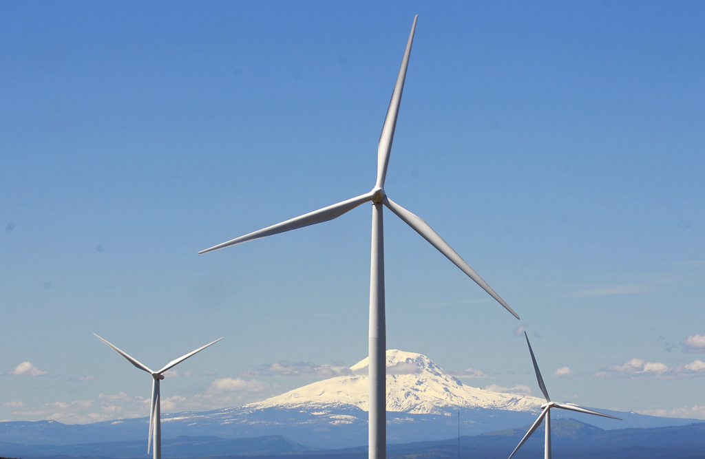 FILE - In this June 3, 2011, file photo, wind turbines stand along the Columbia River Gorge near Goldendale, Wash. Renewable energy dev...