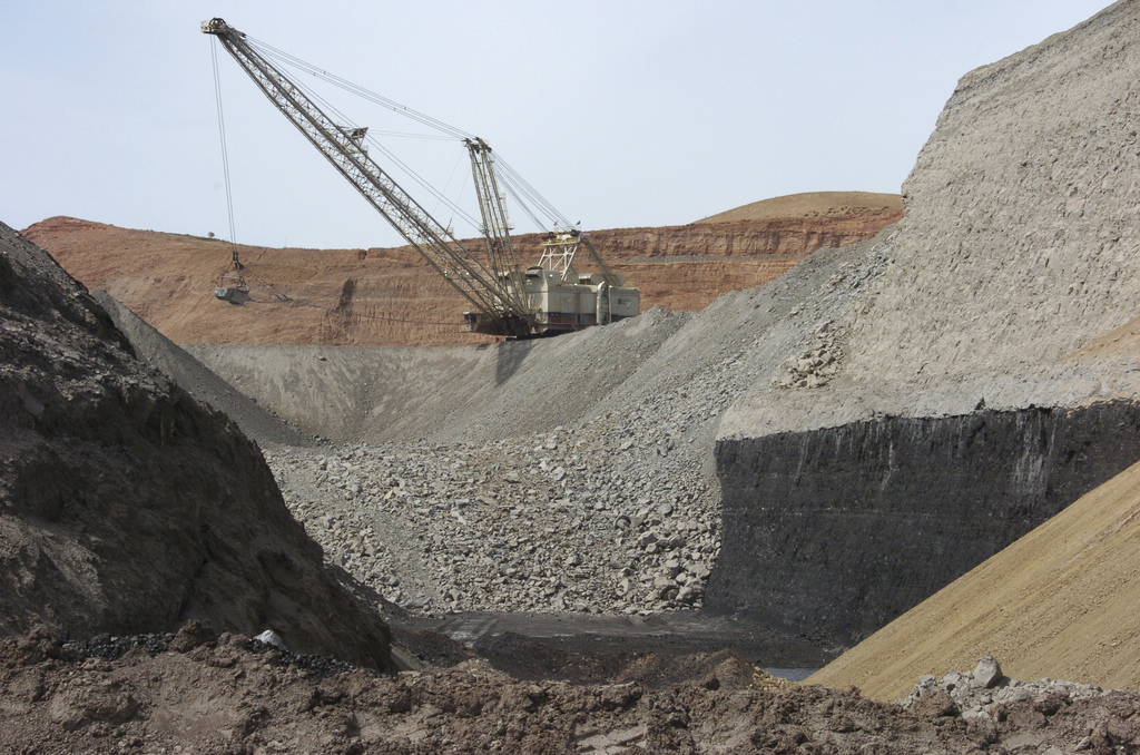 FILE--In this April 4, 2013, file photo, a dragline excavator moves rocks above a coal seam at the Spring Creek Mine in Decker, Mont. R...