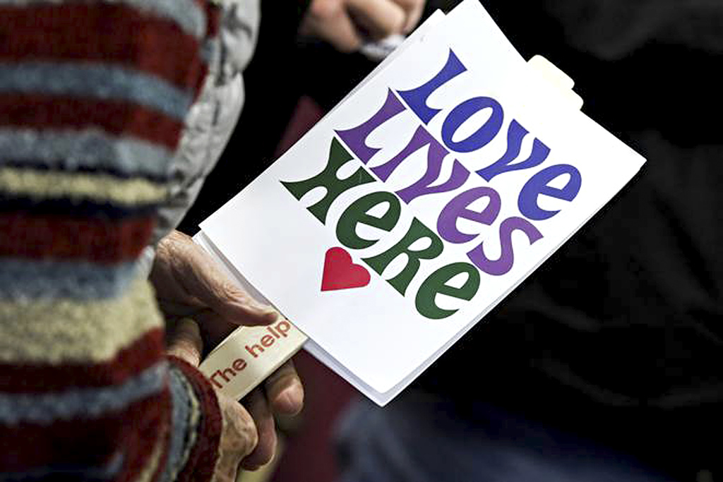 This Nov. 9, 2015 photo shows a Love Lives Here sign pictured outside the Flathead County Justice in Kalispell, Mont. The group, which ...