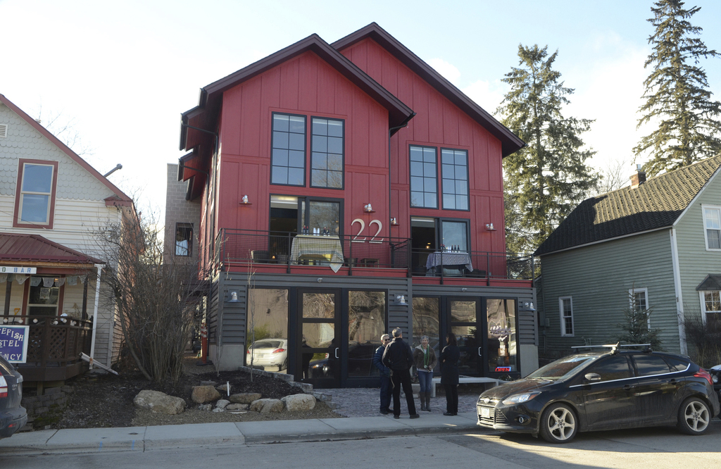 This March 2016 photo shows the mixed-use building owned by Sherry Spencer in Whitefish, Mont. She says her retail tenants have been ta...