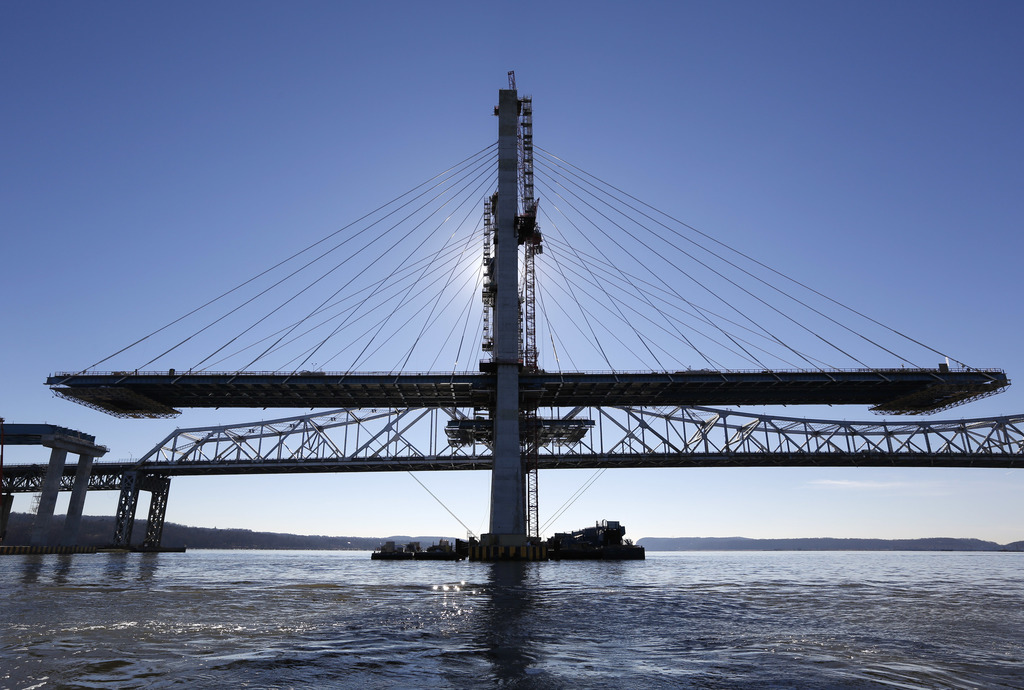 A span on the new Tappan Zee Bridge, foreground, awaits completion while motorists continue to use the older bridge near Tarrytown, N.Y...