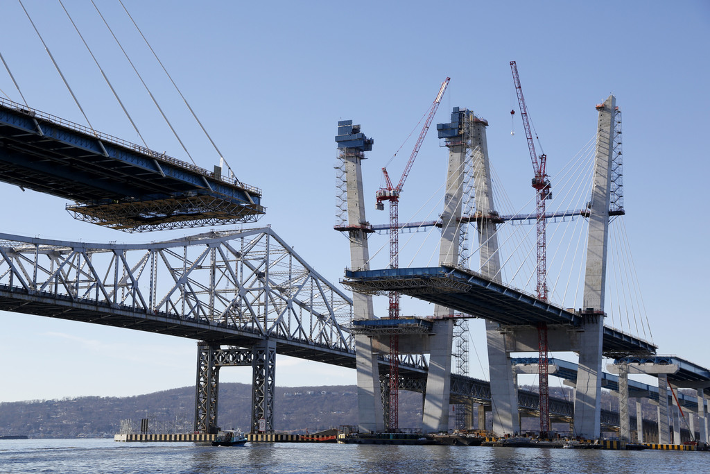 Work continues on the new Tappan Zee Bridge, foreground, while the older one is still in use near Tarrytown, N.Y., Tuesday, Dec. 20, 20...