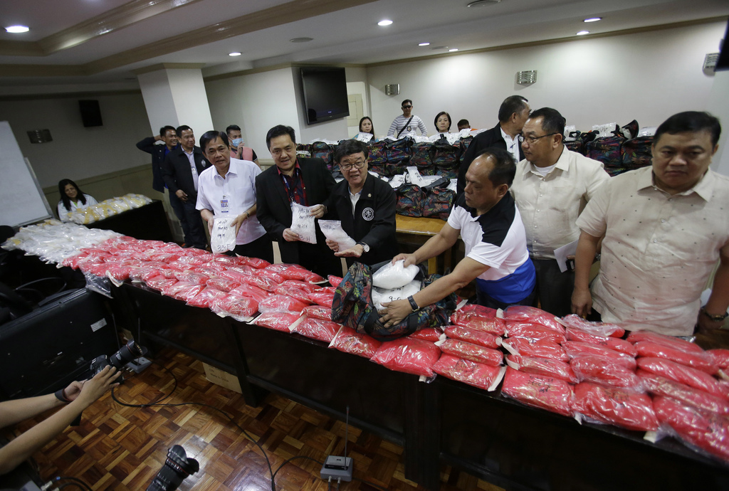 Philippine Justice Secretary Vitaliano Aguirre II, center, and National Bureau of Investigation Director Dante Gierran, 3rd from right,...