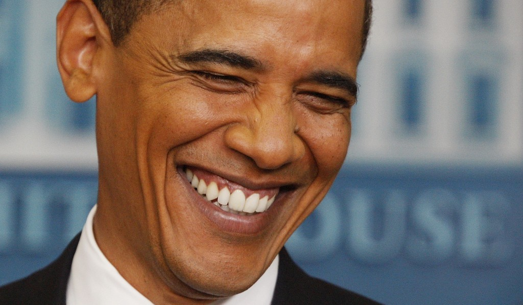 FILE - In this June 23, 2009, file photo, President Barack Obama smiles as he listens to a question during a news conference at the Whi...