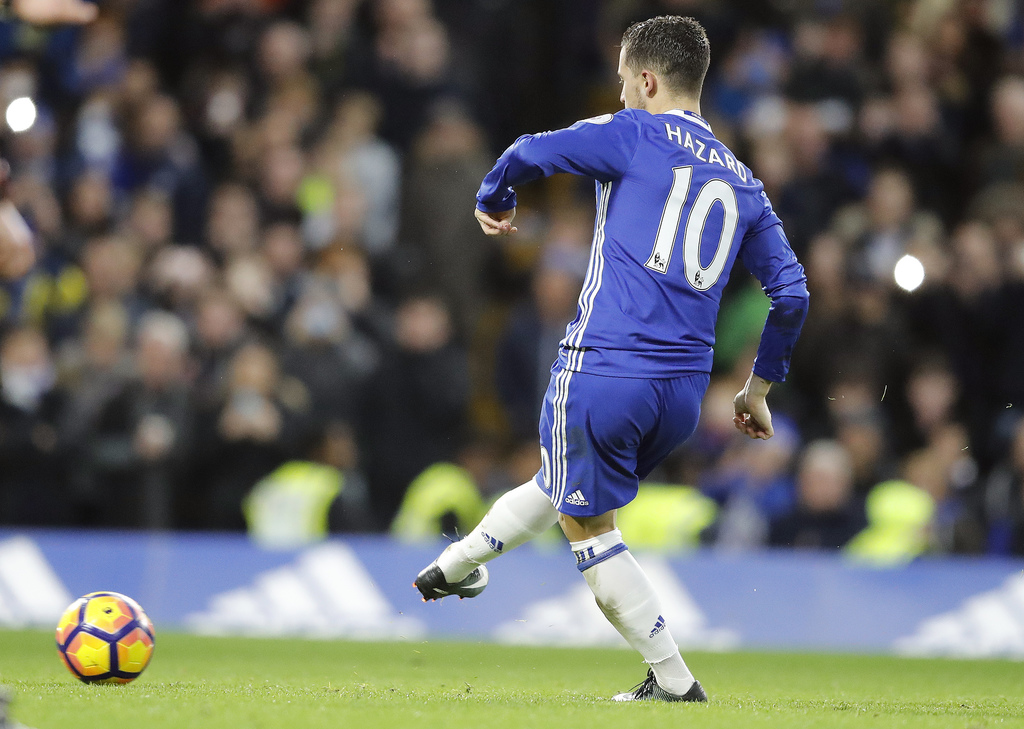 Chelsea's Eden Hazard scores with a penalty kick during the English Premier League soccer match between Chelsea and Bournemouth at Stam...
