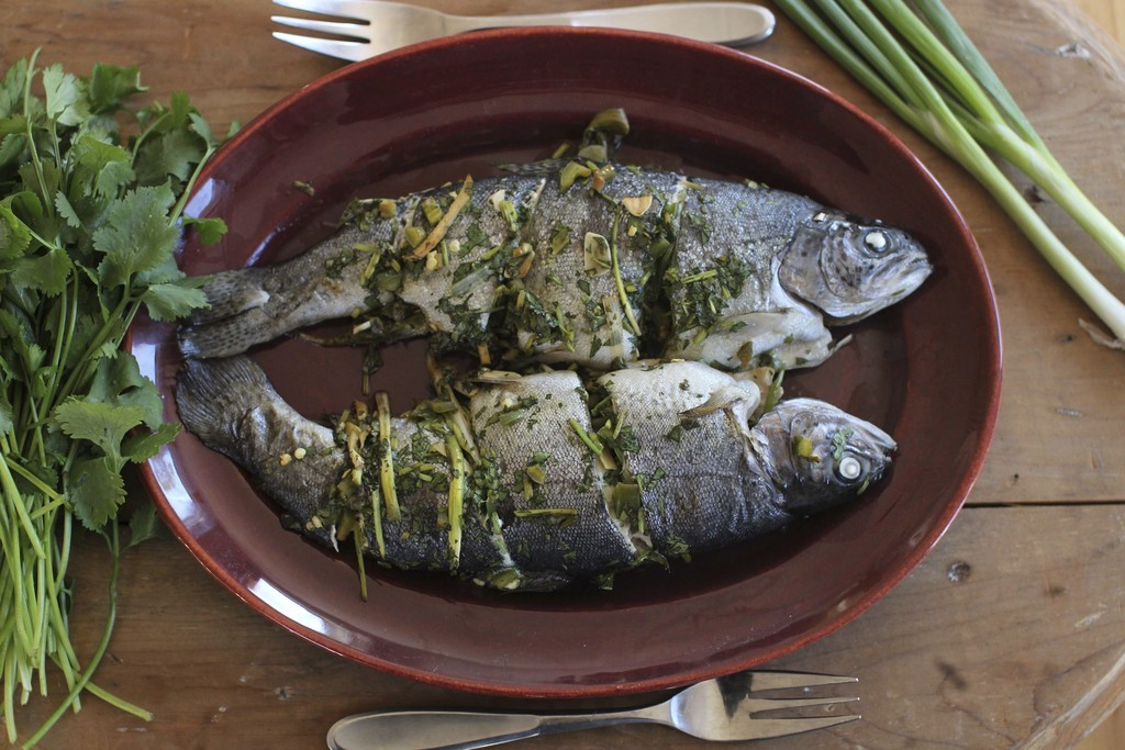 FILE - This Nov. 16, 2015, file photo shows baked whole fish in Concord, N.H. This dish is from a recipe by Sara Moulton. (AP Photo/Mat...