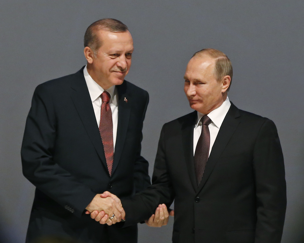 FILE -- In this Oct. 10, 2016 file photo, Turkey's President Recep Tayyip Erdogan, left and Russian President Vladimir Putin, shake han...