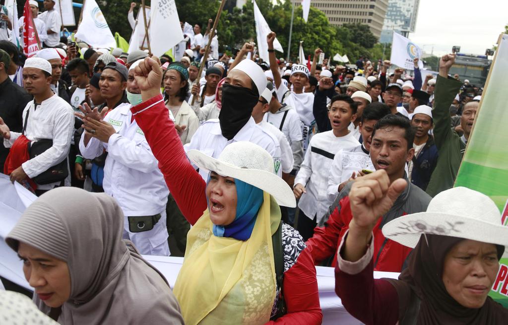 "Muslim women shout slogans during a protest against Jakarta Governor Basuki ""Ahok"" Tjahaja Purnama outside the North Jakarta Court wher..."