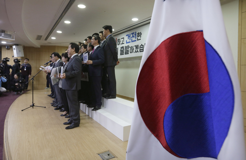 A group of lawmakers of the ruling Saenuri Party attends a press conference to announce to leave the party at the National Assembly in ...