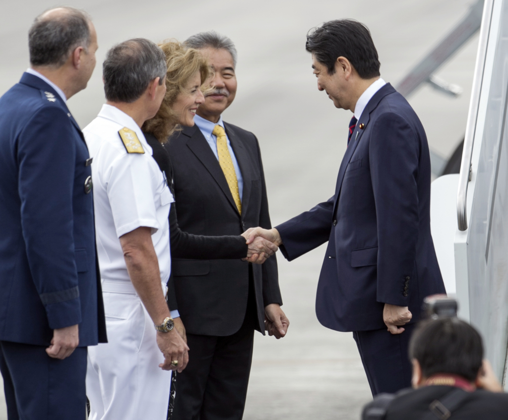 Caroline Kennedy, U.S. Ambassador to Japan, third from left, greets Japan's Prime Minister Shinzo Abe at Joint Base Pearl Harbor Hickam...