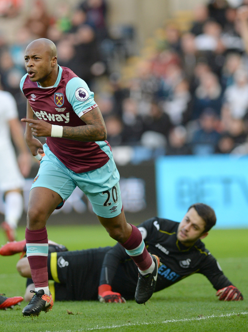 West Ham United's Andre Ayew celebrates scoring his sides opening goal against Swansea during the English Premier League soccar match a...
