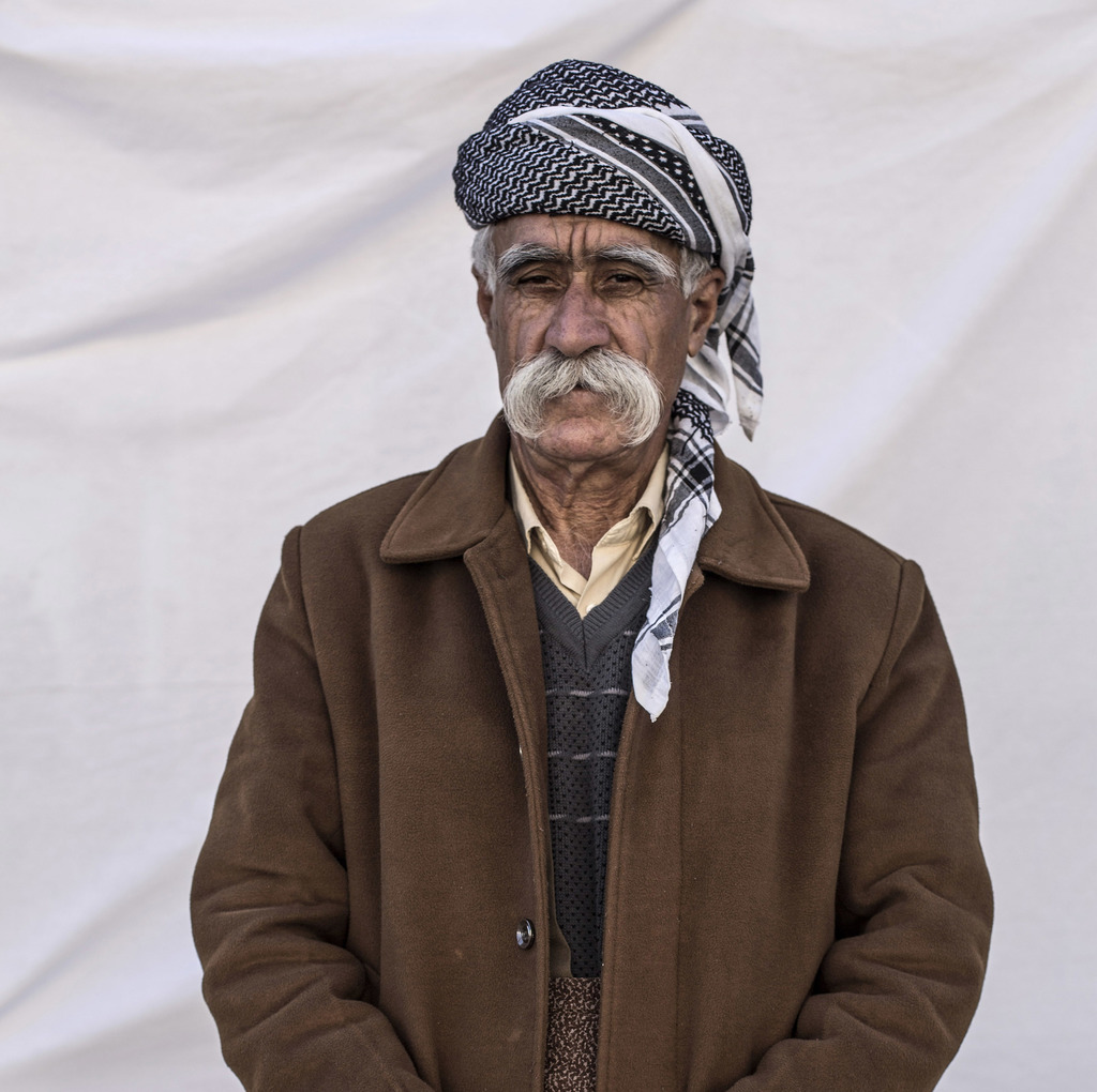 Hamid Khatab Jasm, 77, from Tal Al-Labnin poses for a portrait in a camp where Christians displaced by Islamic State militants are livi...