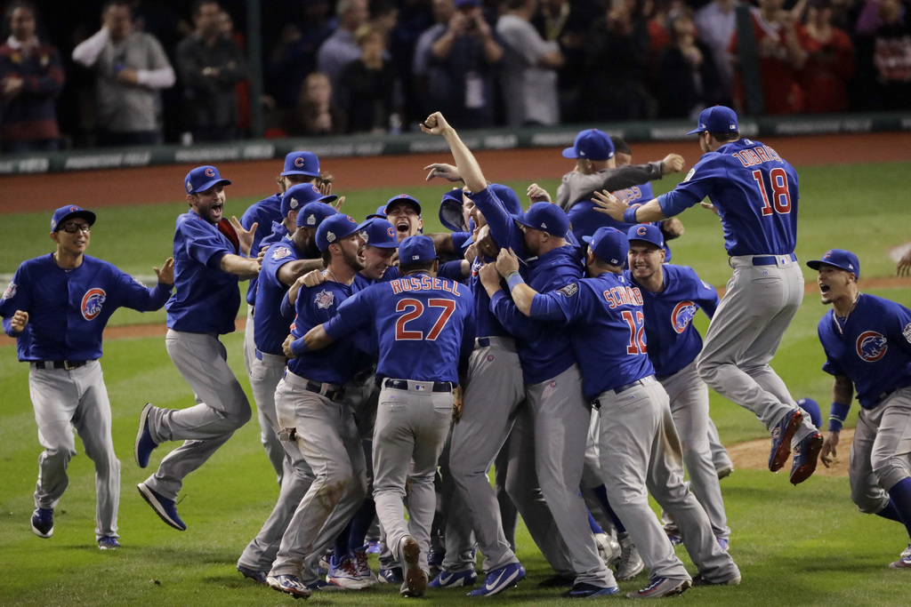 FILE - In this Nov. 3, 2016 file photo, Chicago Cubs celebrate after Game 7 of the Major League Baseball World Series against the Cleve...