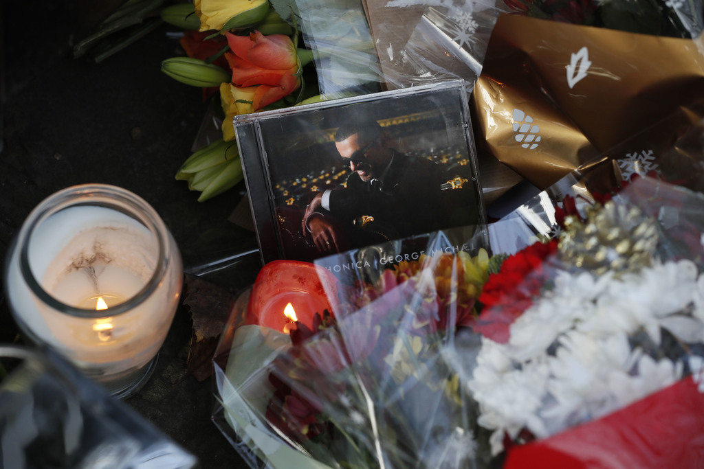 A music CD is left amongst tributes left outside the home of British musician George Michael in London, Monday, Dec. 26, 2016. George M...