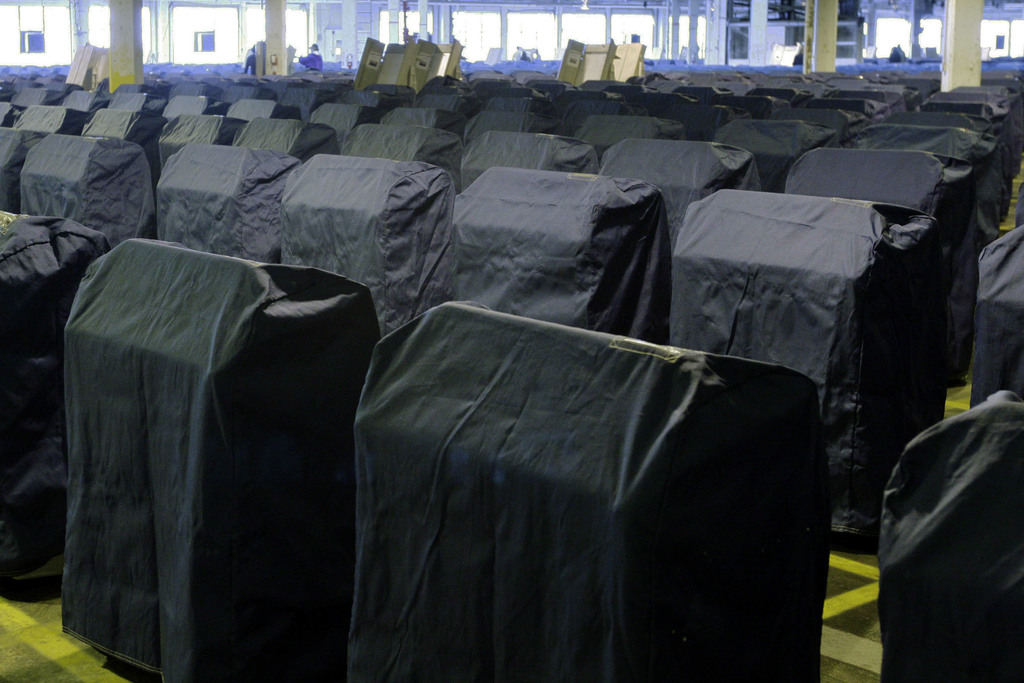 FILE - This Oct. 24, 2008 file photo shows covered voting machines in Philadelphia. Pennsylvania is one of the states that rely on anti...