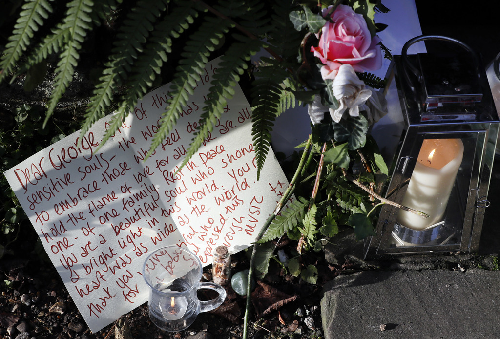 Tributes left outside the home of British musician George Michael in London, Monday, Dec. 26, 2016. George Michael, who rocketed to sta...