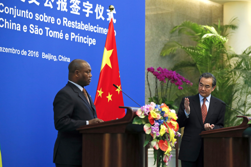 Chinese Foreign Minister Wang Yi, right, speaks next to his Sao Tome counterpart Urbino Botelho during a joint press statement at the D...