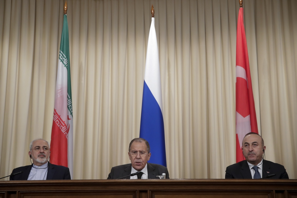 FILE -- In this Tuesday, Dec. 20, 2016 file photo, Iranian Foreign Minister Mohammad Javad Zarif, left, Russian Foreign Minister Sergey...