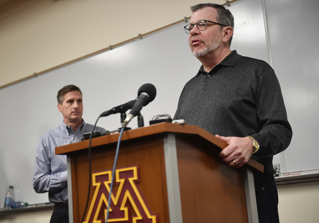 This Dec. 17, 2016 photo shows University of Minnesota President Eric Kaler speaking to the media after players announced the end of th...