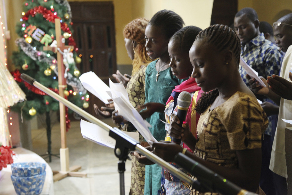 In this photo taken Saturday, Dec. 24, 2016, Catholic faithfuls sing during a mass to celebrate Christmas at Philippe Amore Catholic Ch...