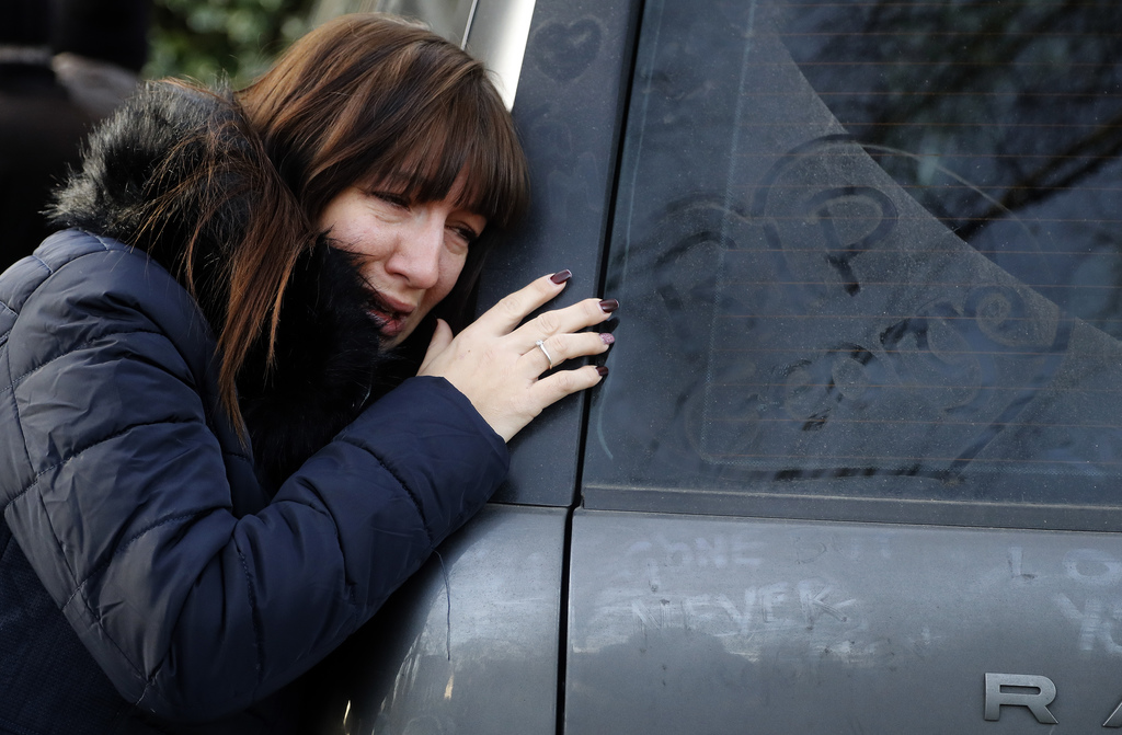 A woman cries outside the home of British musician George Michael in London, Tuesday, Dec. 27, 2016. George Michael, who rocketed to st...