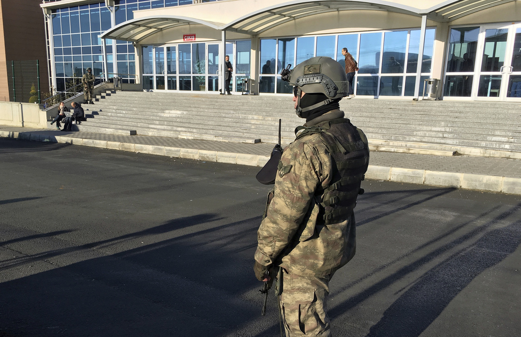 A paramilitary police officer stands at the entrance of Silivri Prison and Courthouse complex where 29 Turkish former police officers a...