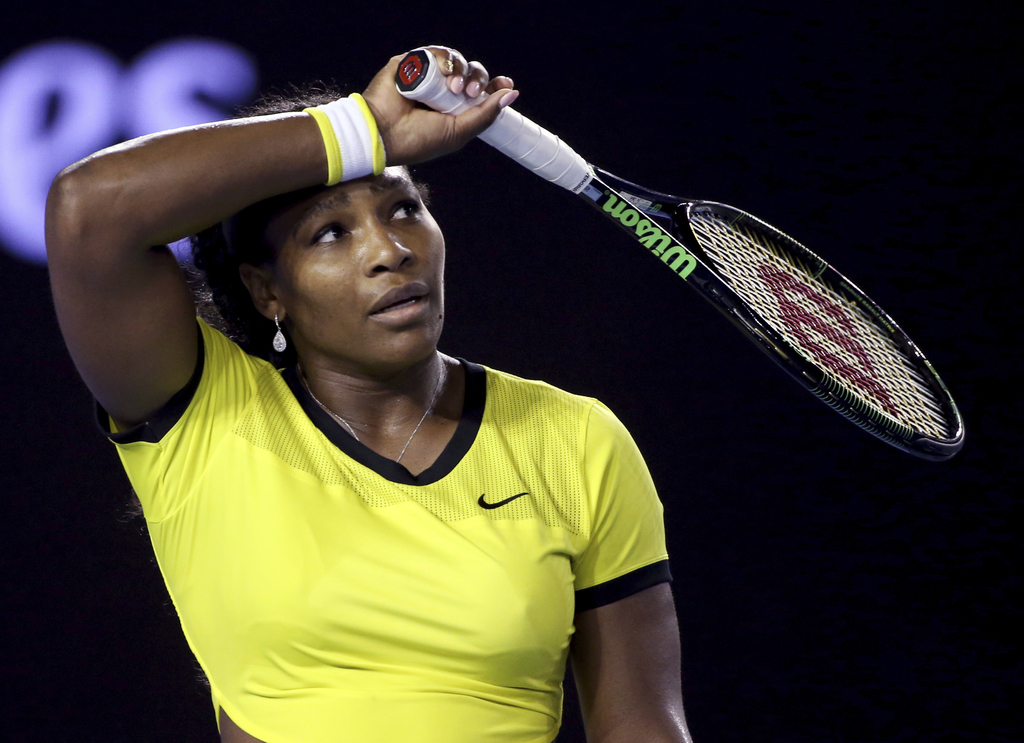 FILE- In this Jan. 30, 2016, file photo, Serena Williams, of the United States, wipes the sweat from her face during her women's single...