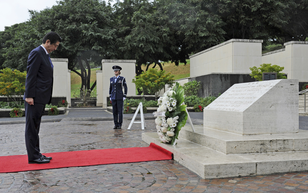 Japanese Prime Minister Shinzo Abe visits the National Memorial Cemetery of the Pacific to place a wreath at the Honolulu Memorial, Mon...