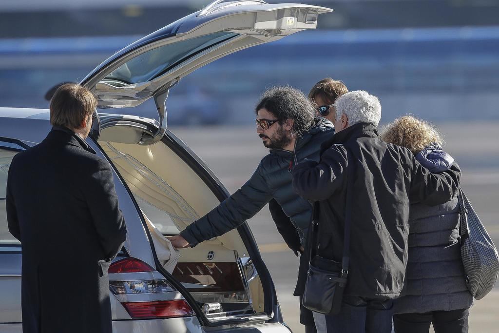 Gerardo Di Agostino touches the coffin of his sister Italian victim Fabrizia Di Lorenzo, as her parents Gaetano Di Lorenzo, second from...