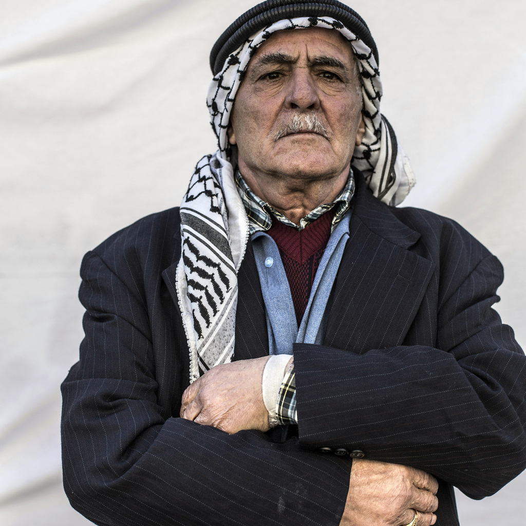 Seleman Hormz, 80, poses for a portrait in a camp where Christians displaced by Islamic State militants are living, in Irbil, Iraq, Fri...